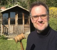 Charles-Hanson-with-his-gavel-outside-his-garden-shed-credit-Hansons event.jpg